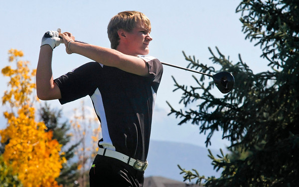 Andrew Howe of Silver Creek High School tees off during the second round of the Colorado High School Activities Association's 4A State Golf Championship at The Links at Cobble Creek in Montrose, Colo., Tuesday, Oct. 2, 2012.<br /> <br /> Photo by Barton Glasser