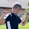 Andrew Howe of Silver Creek High School bites his club after missing a putt during the second round of the Colorado High School Activities Association's 4A State Golf Championship at The Links at Cobble Creek in Montrose, Colo., Tuesday, Oct. 2, 2012.<br /> <br /> Photo by Barton Glasser