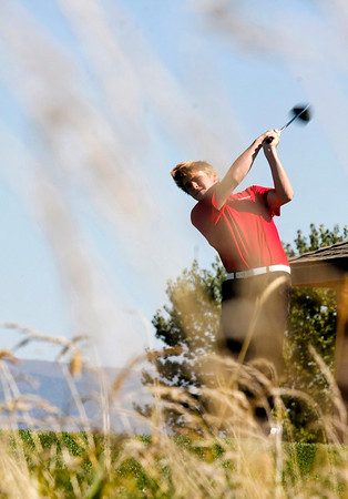 Nick Inslee of Centaurus High School tees off during the second round of the Colorado High School Activities Association's 4A State Golf Championship at The Links at Cobble Creek in Montrose, Colo., Tuesday, Oct. 2, 2012.<br /> <br /> Photo by Barton Glasser