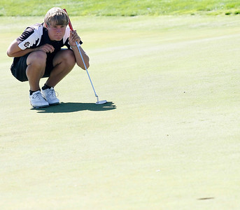 Andrew Howe of Silver Creek High School lines up a putt during the second round of the Colorado High School Activities Association's 4A State Golf Championship at The Links at Cobble Creek in Montrose, Colo., Tuesday, Oct. 2, 2012.  Photo by Barton Glasser