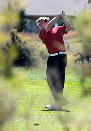 Nick Inslee of Centaurus High School hits from the fairway during the second round of the Colorado High School Activities Association's 4A State Golf Championship at The Links at Cobble Creek in Montrose, Colo., Tuesday, Oct. 2, 2012.<br /> <br /> Photo by Barton Glasser