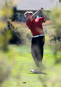 Nick Inslee of Centaurus High School hits from the fairway during the second round of the Colorado High School Activities Association's 4A State Golf Championship at The Links at Cobble Creek in Montrose, Colo., Tuesday, Oct. 2, 2012.  Photo by Barton Glasser