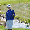 Alex Gorman of Broomfield High School coaxes his ball to the left during the second round of the Colorado High School Activities Association's 4A State Golf Championship at The Links at Cobble Creek in Montrose, Colo., Tuesday, Oct. 2, 2012.<br /> <br /> Photo by Barton Glasser