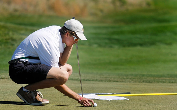 Samuel Toillion of Niwot High School lines up a puttl during the second round of the Colorado High School Activities Association's 4A State Golf Championship at The Links at Cobble Creek in Montrose, Colo., Tuesday, Oct. 2, 2012.<br /> <br /> Photo by Barton Glasser
