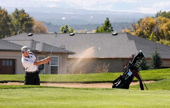 Samuel Toillion of Niwot High School hits from the bunker during the second round of the Colorado High School Activities Association's 4A State Golf Championship at The Links at Cobble Creek in Montrose, Colo., Tuesday, Oct. 2, 2012.<br /> <br /> Photo by Barton Glasser