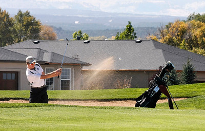 Samuel Toillion of Niwot High School hits from the bunker during the second round of the Colorado High School Activities Association's 4A State Golf Championship at The Links at Cobble Creek in Montrose, Colo., Tuesday, Oct. 2, 2012.  Photo by Barton Glasser