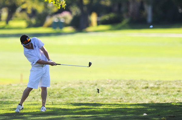 Holy Family High School's Conor Stanley sends his ball up the fairway and onto the 6th hole green during the 2012 CHSAA 3A State Championship held at Denver's Pinehurst Country Club on Tuesday, October 2, 2012. (Kira Horvath/Daily Camera)