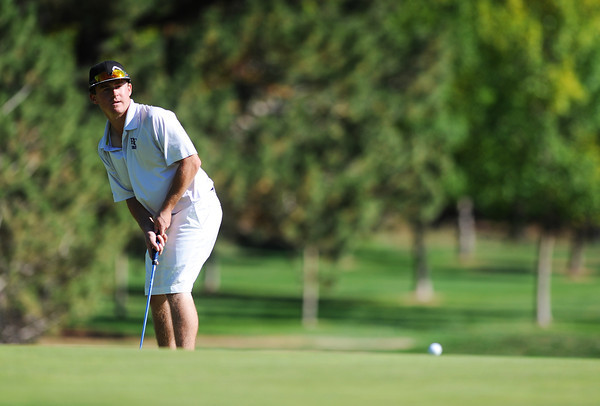 Holy Family High School's Conor Stanley watched his ball just miss the hole as he putts on the 6th hole green during the 2012 CHSAA 3A State Championship held at Denver's Pinehurst Country Club on Tuesday, October 2, 2012. (Kira Horvath/Daily Camera)