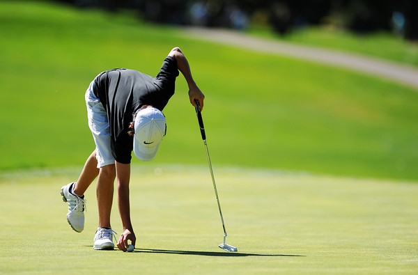 Alexander Dawson's Cole Folwell carefully places his ball at his marker on the 5th hole green during the 2012 CHSAA 3A State Championship held at Denver's Pinehurst Country Club on Tuesday, October 2, 2012. (Kira Horvath/Daily Camera)