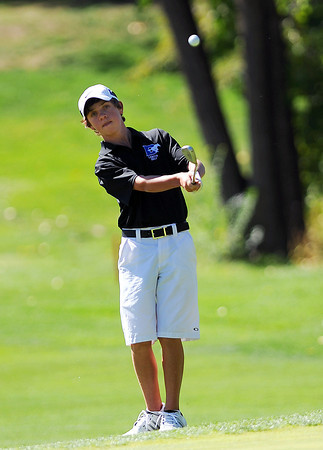 Alexander Dawson's Cole Folwell chips his ball onto the 5th hole green during the 2012 CHSAA 3A State Championship held at Denver's Pinehurst Country Club on Tuesday, October 2, 2012. (Kira Horvath/Daily Camera)