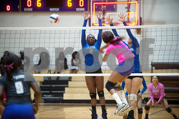 Texas College's Karah Phipps (5) spikes the ball past Jarvis Christian College's Chantavia Johnson (4) and Keshanti Tidwell (5) during their Red River Conference game Thursday night at Texas College's Gus F. Taylor Gymnasium. In five games Texas College won 26-24,19-25, 25-21, 19-25, and 15-7.   (Sarah A. Miller/Tyler Morning Telegraph)