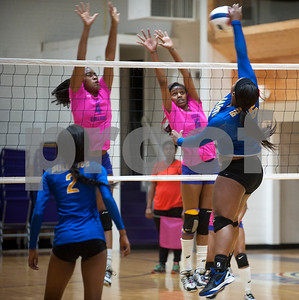 Texas College's Sarah Francis and Karah Phipps jump to try to block Jarvis Christian College's Alassandra Evans' spike during their Red River Conference volleyball game Thursday night at Texas College's Gus F. Taylor Gymnasium. In five games Texas College won 26-24,19-25, 25-21, 19-25, and 15-7.   (Sarah A. Miller/Tyler Morning Telegraph)