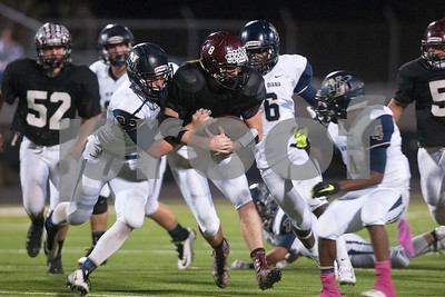 Arp's Tyler Stewart is tackled by New Diana's Aron Jahr in the first half of their game at home against New Diana Thursday night Oct. 22, 2015.  (Sarah A. Miller/Tyler Morning Telegraph)