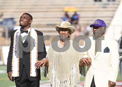 Ms. Homecoming Class of 1966, Tredis Griffin, is escorted by Student Government Association president Terence Washington and Vice President for Student Affairs Dr. Willie Champion during halftime of the homecoming football game held Saturday at Christus Trinity Frances Rose Stadium. Texas College played Wayland Baptist. Griffin was Miss Texas College in 1966.  (Sarah A. Miller/Tyler Morning Telegraph)