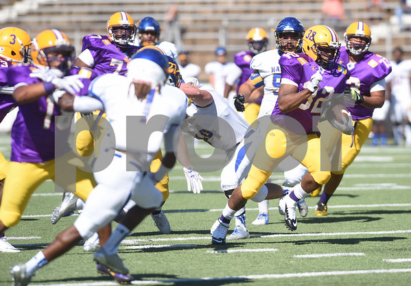 Texas College's (32) Carlos Mosby makes a touchdown run in the first half of their homecoming football game against Wayland Baptist University held Saturday at Christus Trinity Frances Rose Stadium.   (Sarah A. Miller/Tyler Morning Telegraph)