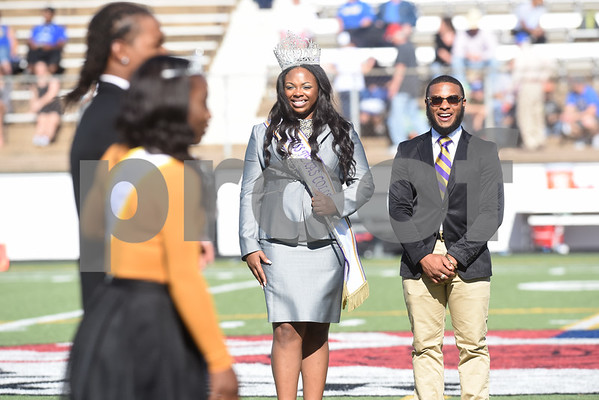 Miss Texas College Taylor J. Pierce is escorted by Dewayne Hicks, Jr. during halftime of the homecoming football game held Saturday at Christus Trinity Frances Rose Stadium. Texas College played Wayland Baptist.  (Sarah A. Miller/Tyler Morning Telegraph)