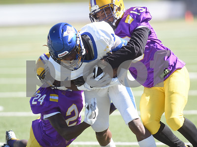 Texas College's (24) Cedric Butler and (13) Antonio Mims tackle Wayland Baptist's Trey Rowe during the homecoming football game held Saturday at Christus Trinity Frances Rose Stadium.   (Sarah A. Miller/Tyler Morning Telegraph)