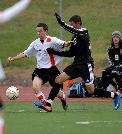 Fairview's Matt Ginley-Hidinger (left) races Eaglecrest's Tarek Qadan (right) for the ball during their soccer game at Fairview High School in Boulder, Colorado October 25, 2011.  CAMERA/Mark Leffingwell