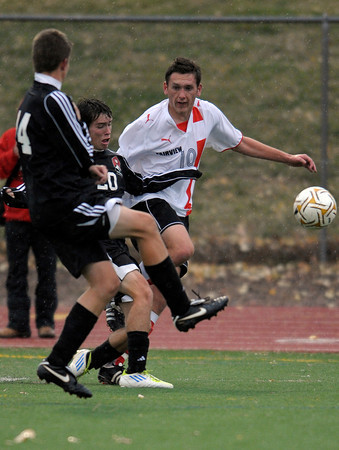 Fairview's Shane O'Neill (right) has his shot blocked by Eaglecrest's Andrew Martinez (middle) and Gunner Dickey (left) during their soccer game at Fairview High School in Boulder, Colorado October 25, 2011.  CAMERA/Mark Leffingwell