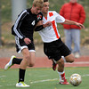 Fairview's Amos Nash (right) pushes off Eaglecrest's Ben Demming (left) during their soccer game at Fairview High School in Boulder, Colorado October 25, 2011.  CAMERA/Mark Leffingwell