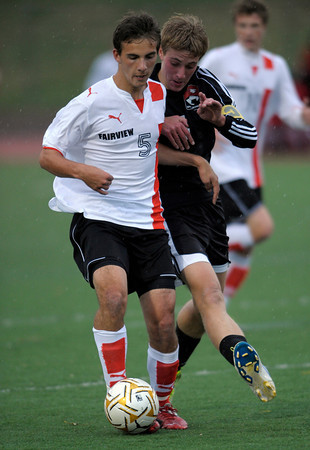 Fairview's Amos Nash (left) passes the ball away from Eaglecrest's Ben Demming (right) during their soccer game at Fairview High School in Boulder, Colorado October 25, 2011.  CAMERA/Mark Leffingwell