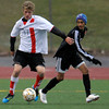 Fairview's Dustin Levine (left) passes the ball away from Eaglecrest's Armando Perez (right) during their soccer game at Fairview High School in Boulder, Colorado October 25, 2011.  CAMERA/Mark Leffingwell
