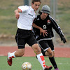 Fairview's Amos Nash (left) fights Eaglecrest's Michael England (right) for the ball during their soccer game at Fairview High School in Boulder, Colorado October 25, 2011.  CAMERA/Mark Leffingwell