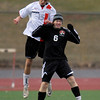 Fairview's Enda O'Neill (left) heads the ball away from Eaglecrest's Anthony Barker (right) during their soccer game at Fairview High School in Boulder, Colorado October 25, 2011.  CAMERA/Mark Leffingwell