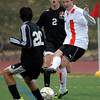 Fairview's Eric Kronenberg (right) passes the ball past Eaglecrest's Andrew Martinez (left) and Creede Wheeler (middle) during their soccer game at Fairview High School in Boulder, Colorado October 25, 2011.  CAMERA/Mark Leffingwell