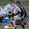 Fairview's Bryan Windsor (left) works past Eaglecrest's Andrew Martinez (right) with the ball during their soccer game at Fairview High School in Boulder, Colorado October 25, 2011.  CAMERA/Mark Leffingwell