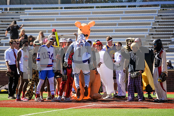 A team surrounds home plate to celebrate a home run by one of their players as he runs in during Tyler Junior College's halloween game at Mike Carter Field in Tyler, Texas, on Wednesday, Oct. 25, 2017. The team plays an annual halloween game in costume. (Chelsea Purgahn/Tyler Morning Telegraph)