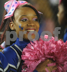 photo by Sarah A. Miller/Tyler Morning Telegraph  John Tyler High School cheerleader senior LaKia Harris uses pink pom pons for breast cancer awareness month Friday night at Trinity Mother Frances Rose Stadium.