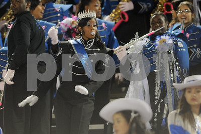 photo by Sarah A. Miller/Tyler Morning Telegraph  John Tyler High School marching band drum major senior Kiara Ross wears her Homecoming queen crown as she performs with her band in the stands Friday night at Trinity Mother Frances Rose Stadium in Tyler.
