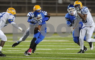 photo by Sarah A. Miller/Tyler Morning Telegraph  John Tyler senior Greg Ward is tackled by Jacksonville senior Nick Ornick Friday night at Trinity Mother Frances Rose Stadium.
