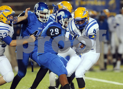 photo by Sarah A. Miller/Tyler Morning Telegraph  Jacksonville's (4) senior LaDarius Session is tackled by John Tyler junior Jose Perez Friday night at Trinity Mother Frances Rose Stadium.