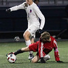 Fairview's Jack Salamon kicks the ball away from Alex Szekely of Bay near midfield. Randy Meyers -- The Morning Journal