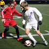 Evan Taylor of Bay works the ball along the sideline against Fairview's Ben Krueger during the first half of a district semifinal on Oct. 26. Randy Meyers -- The Morning Journal
