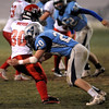 Fairview's Ben Meyer (left) is tackled by Ralston Valley's Trae Russell (right) during their football game at the North Area Athletic Complex in Arvada, Colorado October 27, 2011.  CAMERA/Mark Leffingwell