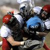 Fairview's Jack Madden (left) and Adam Belford (right) tackle Ralston Valley's Lukas Russell (middle) during their football game at the North Area Athletic Complex in Arvada, Colorado October 27, 2011.  CAMERA/Mark Leffingwell
