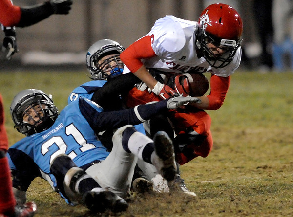Fairview's Will Stoorman (right) is tackled by Ralston Valley's Cory Witt (middle) Spencer Svejear (left) during their football game at the North Area Athletic Complex in Arvada, Colorado October 27, 2011.  CAMERA/Mark Leffingwell