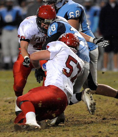 Fairview's Adam Belford (left) and Carsen Will (right) sandwich Ralston Valley's Lukas Russell (middle) during their football game at the North Area Athletic Complex in Arvada, Colorado October 27, 2011.  CAMERA/Mark Leffingwell
