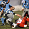 Fairview's Carsen Will (right) drags down Ralston Valley's Dominic Vessa (left) during their football game at the North Area Athletic Complex in Arvada, Colorado October 27, 2011.  CAMERA/Mark Leffingwell