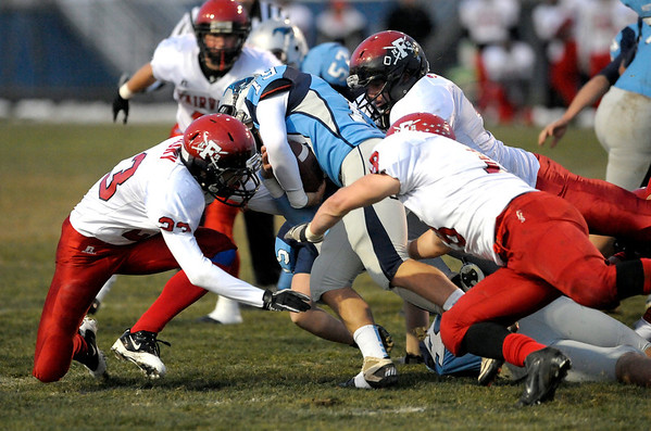 Fairview's Nick Nasky (left), Sevrin Remmo (back right) and Jack Madden (front right) tackle Ralston Valley's Jake DeGrace (middle) during their football game at the North Area Athletic Complex in Arvada, Colorado October 27, 2011.  CAMERA/Mark Leffingwell