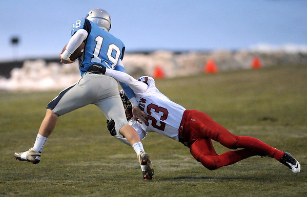 Fairview's Nick Nasky misses tackling Ralston Valley's Jake DeGrace (right) during their football game at the North Area Athletic Complex in Arvada, Colorado October 27, 2011.  CAMERA/Mark Leffingwell