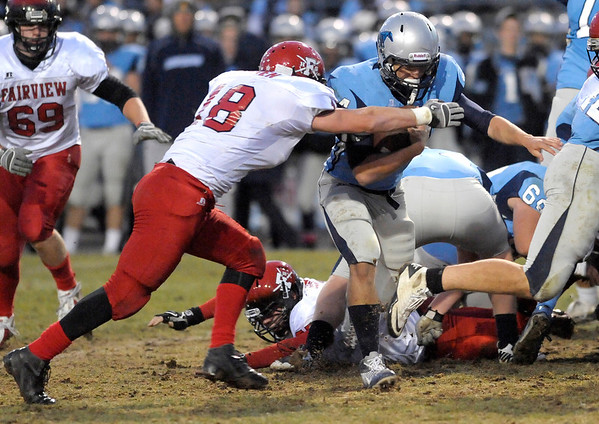 Fairview's Jack Madden (left) tackles Ralston Valley's Reilly Hauptman (right) during their football game at the North Area Athletic Complex in Arvada, Colorado October 27, 2011.  CAMERA/Mark Leffingwell
