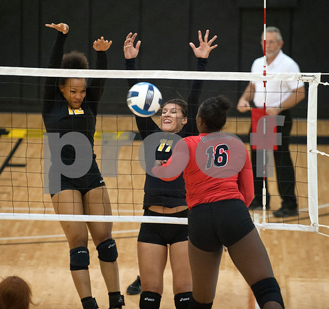 Tyler Junior College's Halee Brewer and Eileen Acuna block the ball spiked by Navarro's Tielar Richards (16) during their volleyball game at home against Navarro College Wednesday Oct. 28, 2015.  (Sarah A. Miller/Tyler Morning Telegraph)