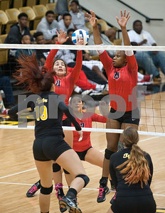 Navarro's Sydney James and Mi'Kayla Benson can't block the spike from Tyler Junior College's Aleksandra Gligoric  during their volleyball game at home against Navarro College Wednesday Oct. 28, 2015.  (Sarah A. Miller/Tyler Morning Telegraph)