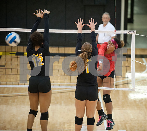 Navarro's Daisge Smith spikes the ball past Tyler Junior College's Halee Brewer and Kellyn Reeves during their volleyball game at home against Navarro College Wednesday Oct. 28, 2015.  (Sarah A. Miller/Tyler Morning Telegraph)