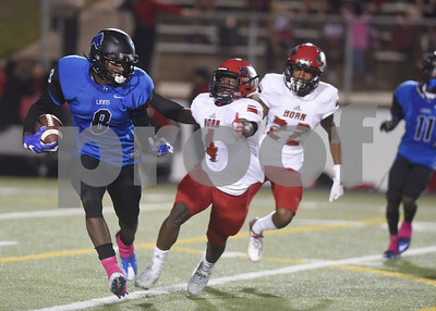 Mesquite Horn's Elton Taylor tries to stop John Tyler's Damion Miller during their game Friday night at Christus Trinity Mother Frances Rose Stadium.  (Sarah A. Miller/Tyler Morning Telegraph)