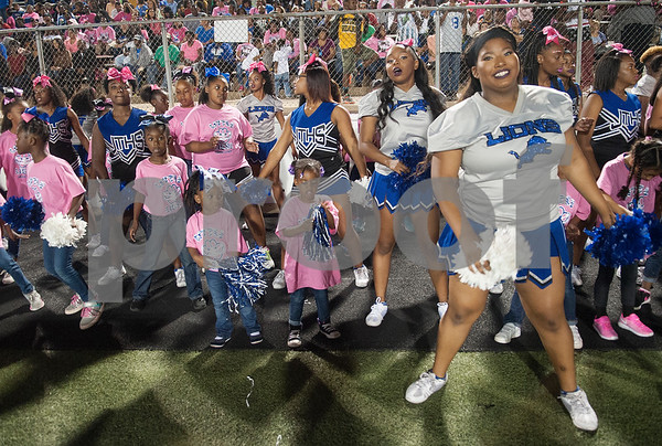 Girls from Little Lions Cheer Clinic perform alongside cheerleaders from John Tyler High School during their game Friday night at Christus Trinity Mother Frances Rose Stadium.  (Sarah A. Miller/Tyler Morning Telegraph)